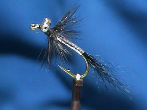 Hook: Nymph #6 - #12 Thread: Black Eyes: Beadchain Tail: Black Bucktail Body: Silver Tinsel Hackle: Black