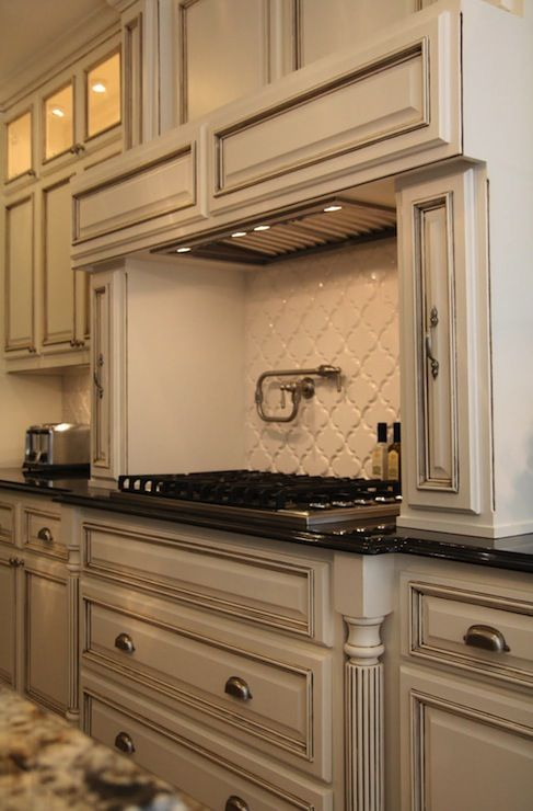 Suzie: M. E. Beck Design - Antique ivory kitchen cabinets with polished granite black ...