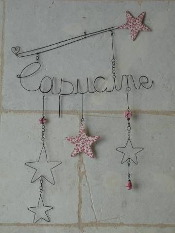 Child's name in wire (by De Baux)
