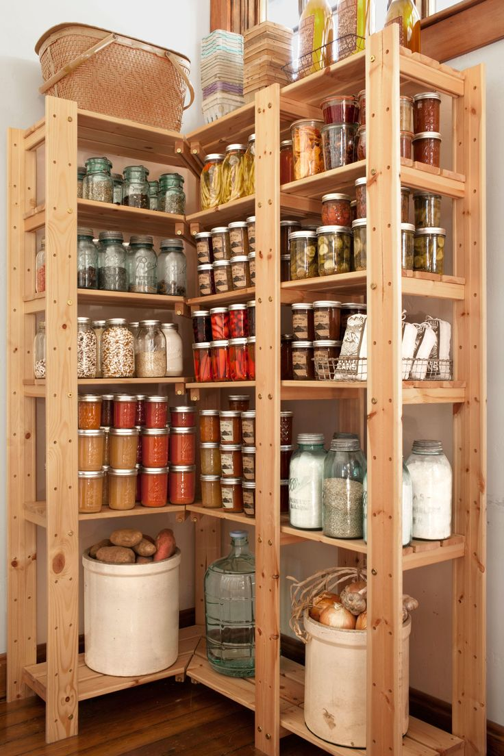 Don't waste your kitchen closet on buckets and a broom. Tall shelving units transform this space into a pantry that maximizes corners.