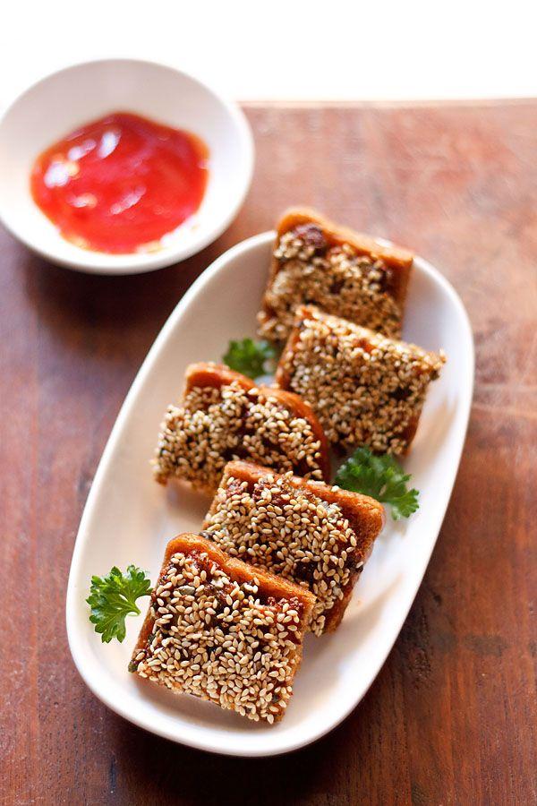 sesame veg toast recipe – indo chinese starter snack of crisp, golden fried toast stuffed with veggies and topped with sesame. step by step recipe.  #sesame #toast