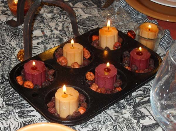 Love this! Buy a cheap cupcake tin, spray paint, then decorate with candles and miniature pumpkins!