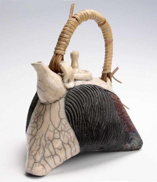 Raku nonfunctional teapot. www.nitaclaise.com. Facebook. Pottery by Nita Claise