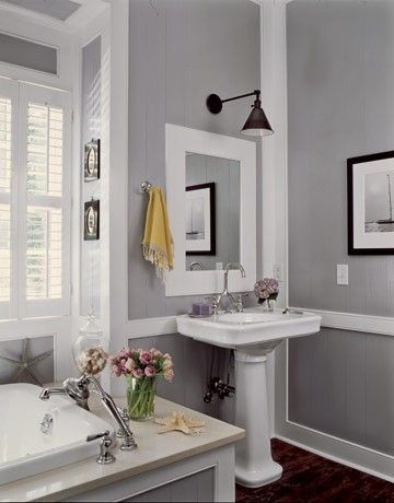 light grey bathroom, white trim.