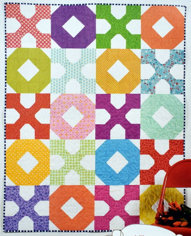 """I often end my texts and emails with 'Jxo', my affectionate way of signing off with my initial followed by 'kiss, hug'. And this is how it translates into a bright and happy quilt!     I submitted this to the February issue of Pretty Patches magazine, who wanted to brighten the dreary … Continue reading """"Hugs & Kisses Quilt"""""""