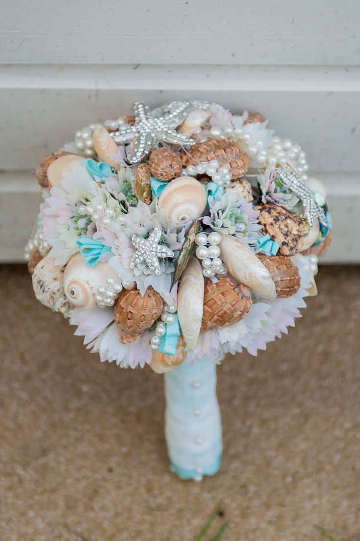 the 25 best beach wedding bouquets ideas on pinterest beach wedding flowers shell bouquet. Black Bedroom Furniture Sets. Home Design Ideas