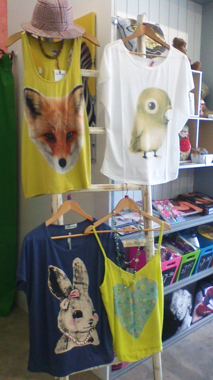 Top left, bottom right, custom made tanks tops. NB: Big face birdie and bunny tees are imports (yes we can order them in for you!)