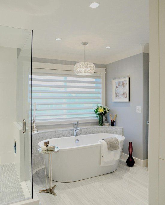 Like the idea of the rounded ledge behind the tub so you have a place to  set things. traditional bathroom by Enviable Designs Inc.love those guys!