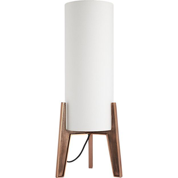 Shop pyra table lamp.   Shining bright with midcentury vibes, metallic light edges ever-so-slightly masculine.  At over 2 feet tall, extra large lamp with towering shade filters light creating a super-soft glow.