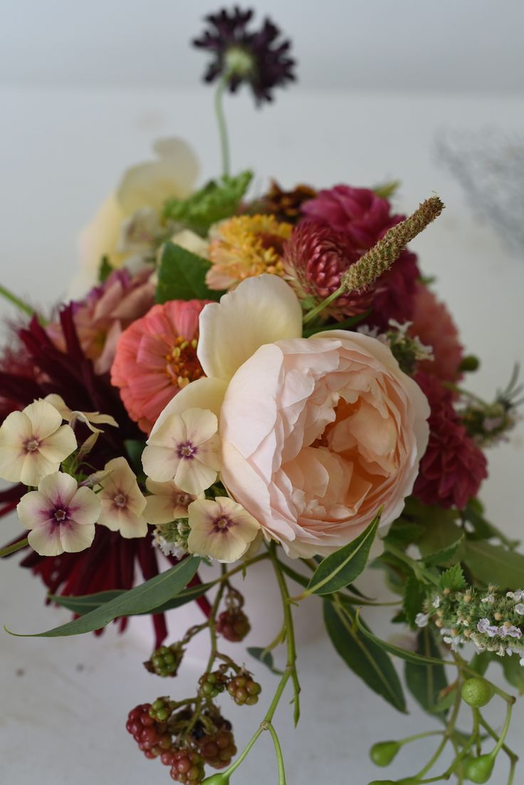 February Wedding, table flowers, centrepieces, red, pink, dahlias, roses, zinnias, Queen Anne's Lace, scented geranium, strawflower, scabiosa, blackberries, phlox
