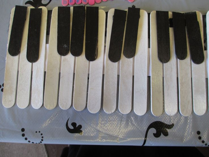 A tongue depressor keyboard craft to be used in my Intro to Piano course. The black keys are removable, (velcro), so that the student can place them on their keyboard at home.
