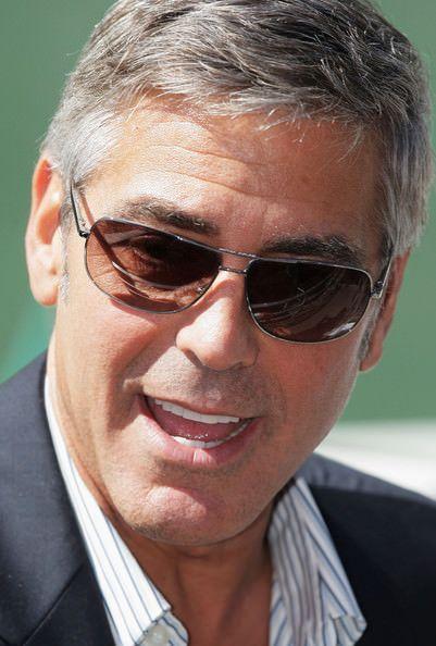 Celebrity  Sunglasses | ... Clooney smiles in his short sunglasses . justshades.net