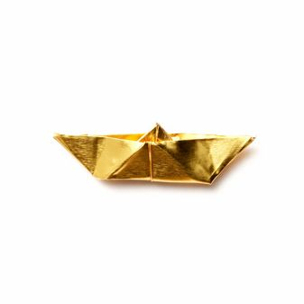 little golden paper boat