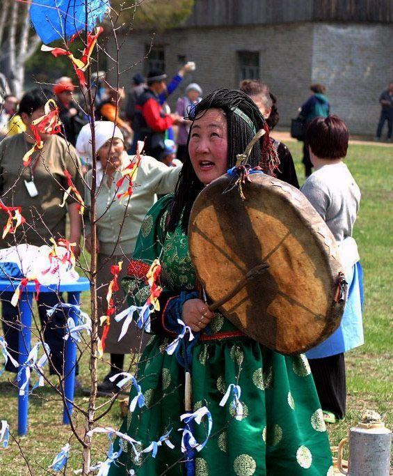 Buryat female Kam(Shaman) drumming.