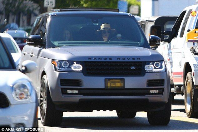 Treating herself: Kendall Jenner reportedly spent $10,000 on vinyl wrapping her Range Rover to match her mother Kris's car