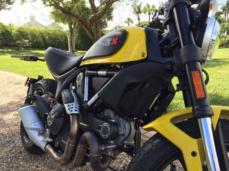 Used 2015 Ducati STREET SCRAMBLER Motorcycles For Sale in Florida,FL. For sale is a yellow 2015 Ducati Icon Scrambler. It has a high and wide handlebar, the round headlight with a LED guide-light, and the Dual Sport wheels. The Scrambler Icon sources the 803cc (88mm bore x 66mm stroke) two-valve air-cooled Twin utilized by the Monster 796. A distinctive header pipe configuration curls into a right-side 2-into-1 exhaust. A wet multi-plate clutch, six-speed gearbox and chain final drive…