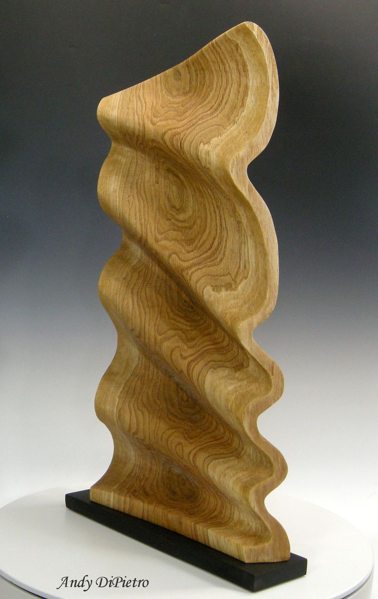 Grain Waves, Abstract wave form that showcases marbled grain figure and medullary rays. Marbled Pin Oak with a carved and sandblasted surface texture, oil finish.