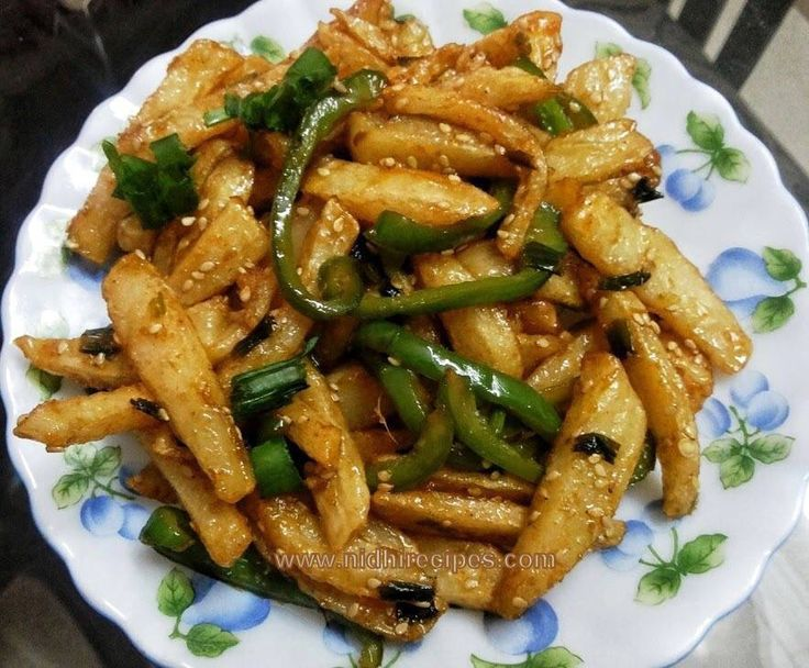Honey Chilli Potatoes...delicious and easy to prepare at home. Kids love them a lot. http://nidhirecipes.com/honey-chilli-potatoes/