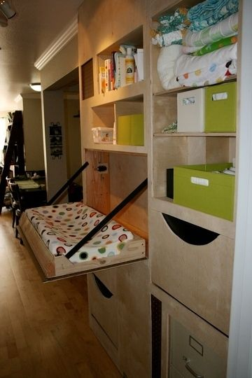 fold down changing table built into shelving