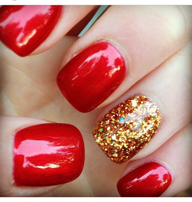 Red nails with sparkly gold. | See more at http://www.nailsss.com/red-nails/2/