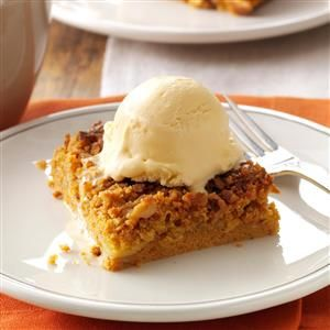 Great Pumpkin Dessert Recipe -Canned pumpkin and yellow cake mix make these bars an effortless alternative to pumpkin pie. It's a tried-and-true dessert that always brings big smiles. —Linda Guyot, Fountain Valley, California