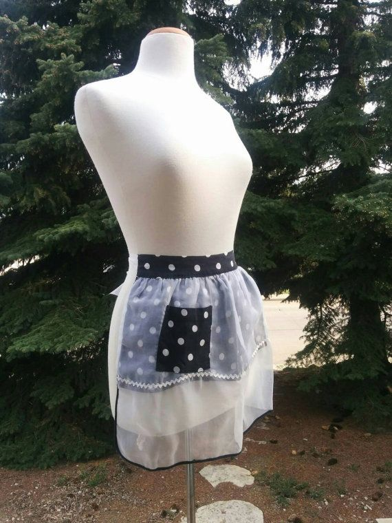Check out this item in my Etsy shop https://www.etsy.com/listing/279499446/vintage-reversible-black-polka-dot-apron