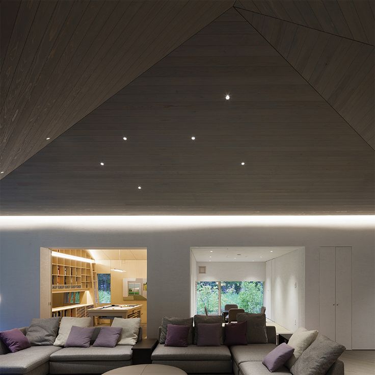 in karuizawa, japan, OFDA architecture office has built a built a megaphone shaped vacation home, inspired by a popular japanese novel.