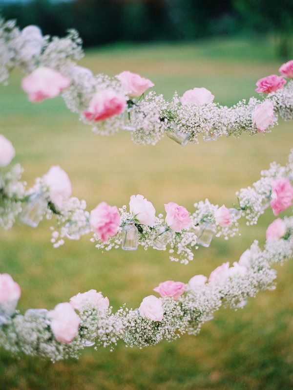 How beautiful of hanging flower pieces! #wedding #flowers #rose #babysbreath
