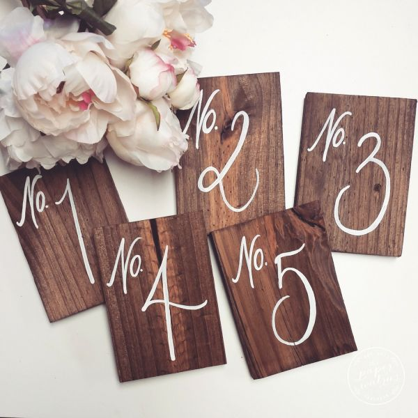 These rustic wooden table numbers are crafted out of hand-painted pine wood stained with a beautiful walnut finish.