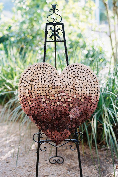 A wine cork heart is a great centerpiece for a vineyard ceremony | Photography by Leah | Brides.com