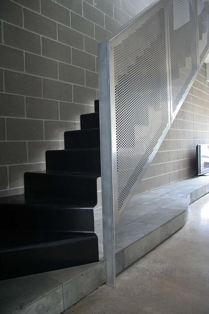 Captivating Floating Steel Treads With Perforated Metal Balustrade.