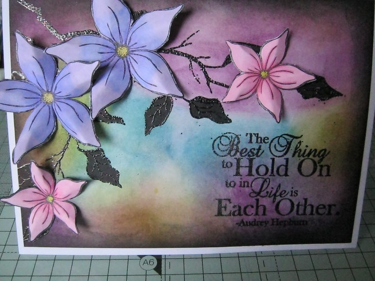 Sheena Douglas Flowers coloured in with Spectrum Noir pens and distress inks background.