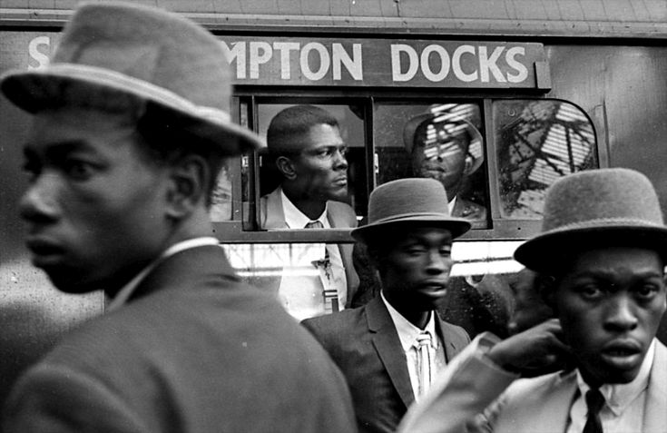 West Indian Arrivals, London, England, United Kingdom, 1962, photograph by Howard Grey.