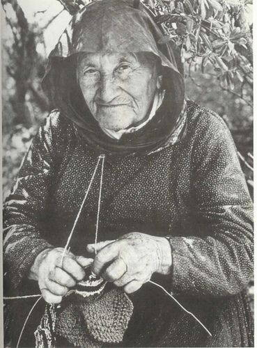 Greek woman knitting. Best suited to purl stitch, great for working multiple colors at one time.
