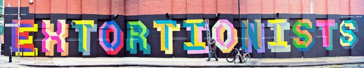 """Ben Einehas been out and about in London over the past few days painting his classic letters in Shoreditch.  The British artist delivers a signature piece which reads """"Extortionists"""", ifyou stop by East London, this one can be seen on Ebor Street, Shoreditch.  Stay tuned for more by Eine soon..."""
