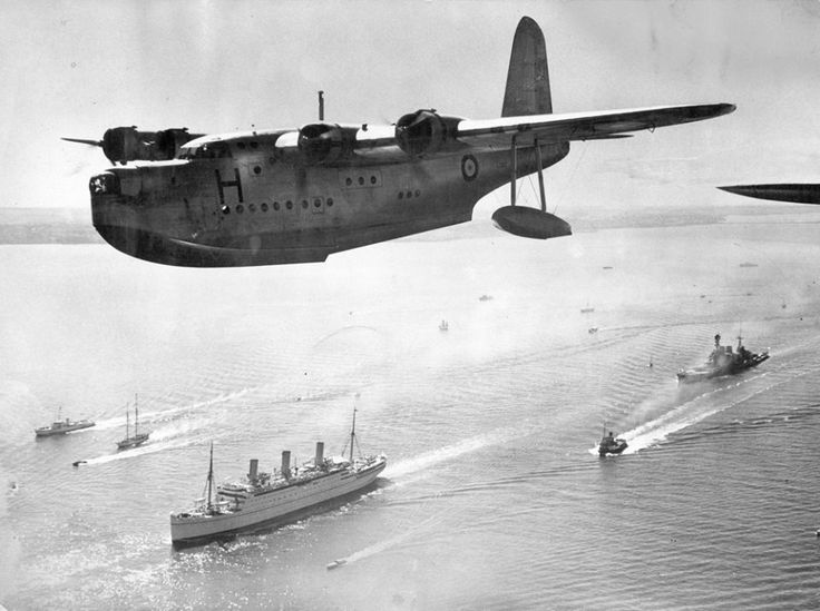 """Sunderland's flying boat escorting the """"Empress of Australia"""" sailing on the English Channel with the King and Queen on board bound for Canada."""