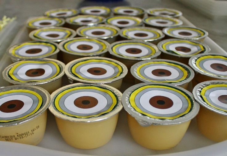 Applesauce with minion eyes as a snack for a minion party.  Click or visit fabeveryday.com for more photos and details from this Despicable Me Minions themed birthday party.