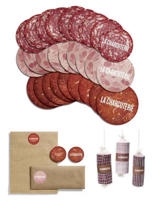Stationery range for La Charcuterie deli/restaurant, Vancouver. Business cards shaped like cold cuts are strung in cured meat style netting. Meat stickers are adhered to letterheads and envelopes (made of butcher paper). Genius! Designed by Rethink.