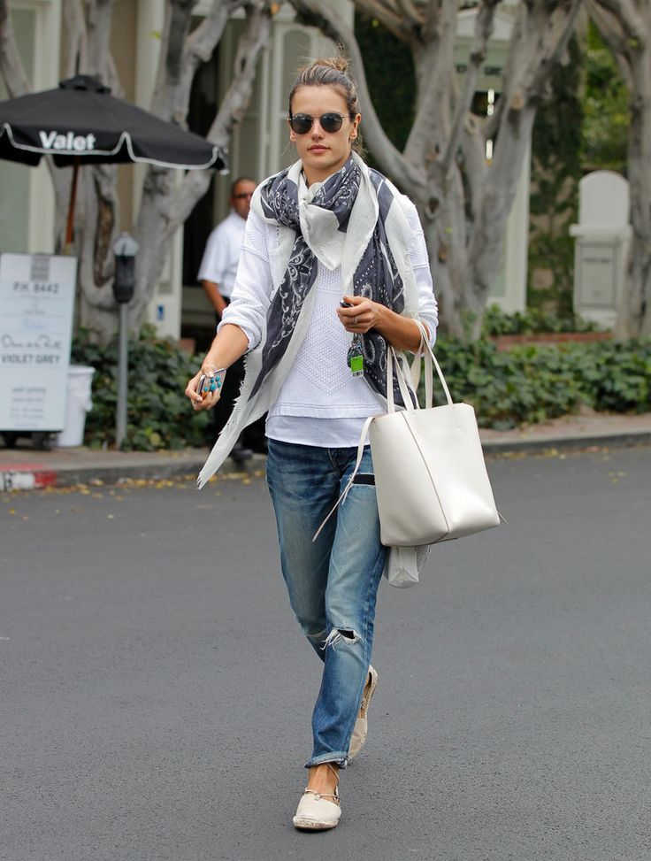 Alessandra Ambrosio mastered the laid-back LA vibe with boyfriend jeans, a white sweater, and a light printed scarf.