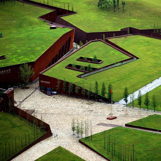 in 2008 a huge earthquake in china's sichuan province was the country's deadliest earthquake for more than 30 years. designed by cai yongjie, the 'wenchuan earthquake memorial museum' takes the form of a ruptured landscape, where large subterranean buildings are topped with green roofs that ensure that the complex adopts an unobtrusive presence. photo by cai yongjie see more about the project on #designboom #architecture