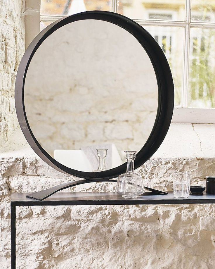 A Very Striking Large Free Standing Dressing Table Mirror With A Round  Black Frame And Base.