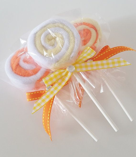 Yellow and Orange gender neutral washcloth lollipops are the perfect add on to any baby shower gift or can even be used for baby shower favors! This set includes three (3) washcloth lollipops. Each lollipop is made with two (2) washcloths each. You will receive one of each design shown. Each washcloth is made of soft terry cotton and measure 9x9 inches. You can use them as an add on to a baby shower gift or order a few for the new mom to be to use later. A new mommy can never have enough…
