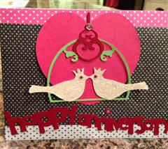 Made this card for my husband. I used the Sophie Cartridge. I put glue on the doves and sprinkled glitter on the doves. I printed the cage/dove three times with three colors to make the cage green, the heart on top red and used off white paper for the doves.