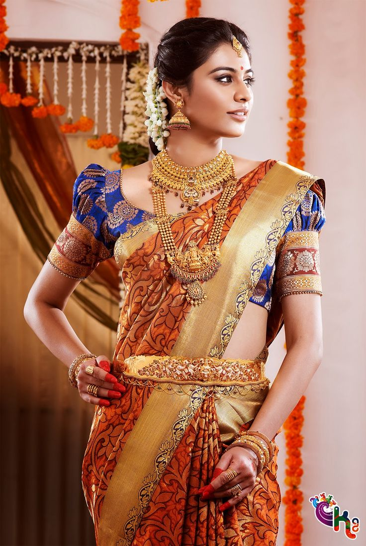 Traditional Southern Indian bride wearing bridal saree, jewellery and makeup.