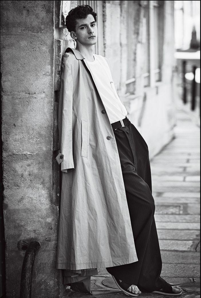 european model wears wide leg wool pants that resemble to the zoo suit