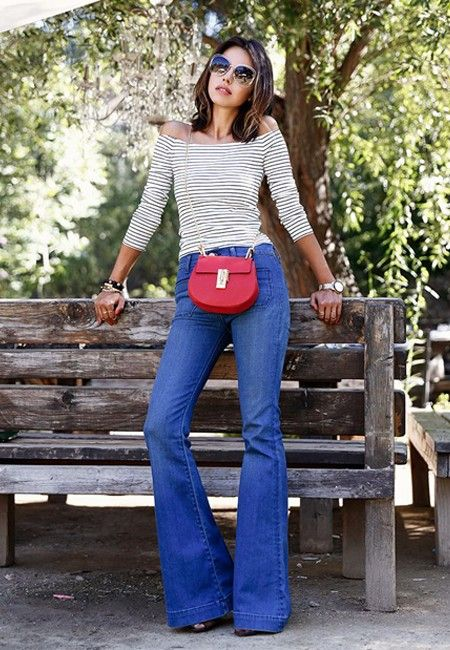 If you've always wanted to wear flares but weren't sure how, here's a foolproof way to do just that. Start with a classic denim style, and pair it with an off-the-shoulder striped top. It's a French girl look that can't be beat.