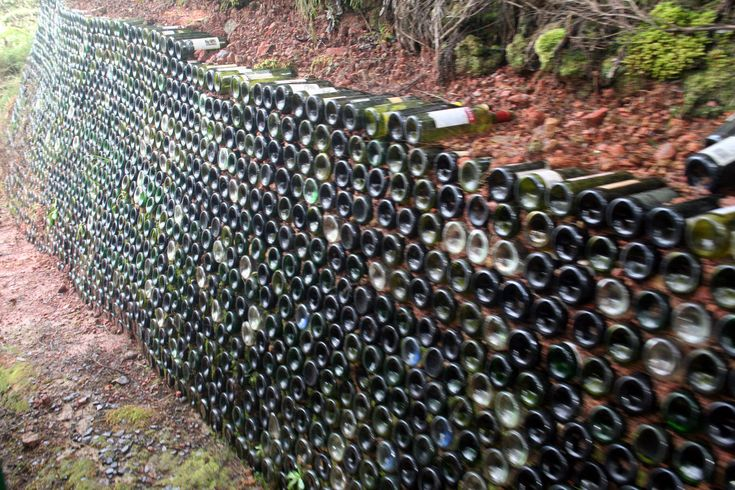 Wine Bottle Retaining Wall  Mountainside... so cool! too bad I have no need of such.