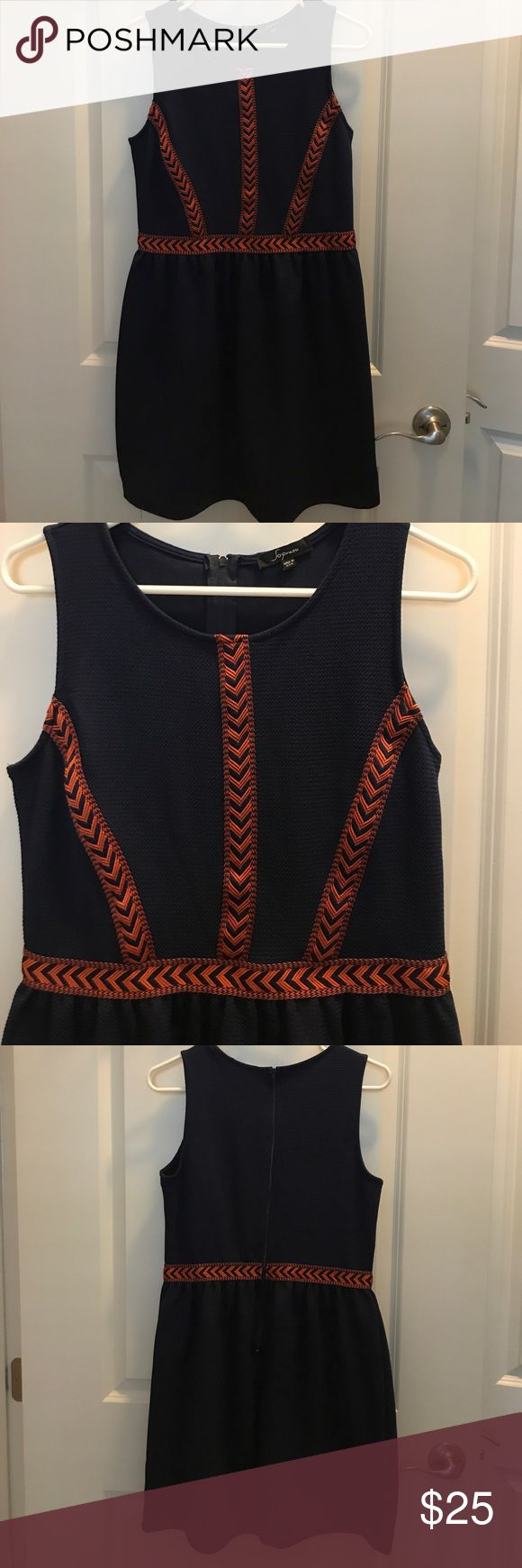 """A Line Navy Dress with Orange Accents A line textures navy dress with orange chevron detail. Dress is polyester so it breathes nicely.  Size Large.  Bust is 36"""" but could stretch to 37"""" without tugging. Waist is 31"""" skirt length from waist to bottom hem is 19"""" Soprano Dresses"""