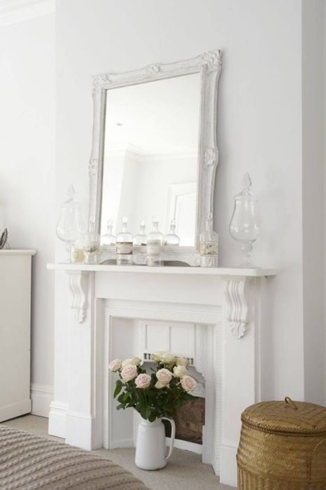 Love the resting mirror and vase of tall flowers on the floor