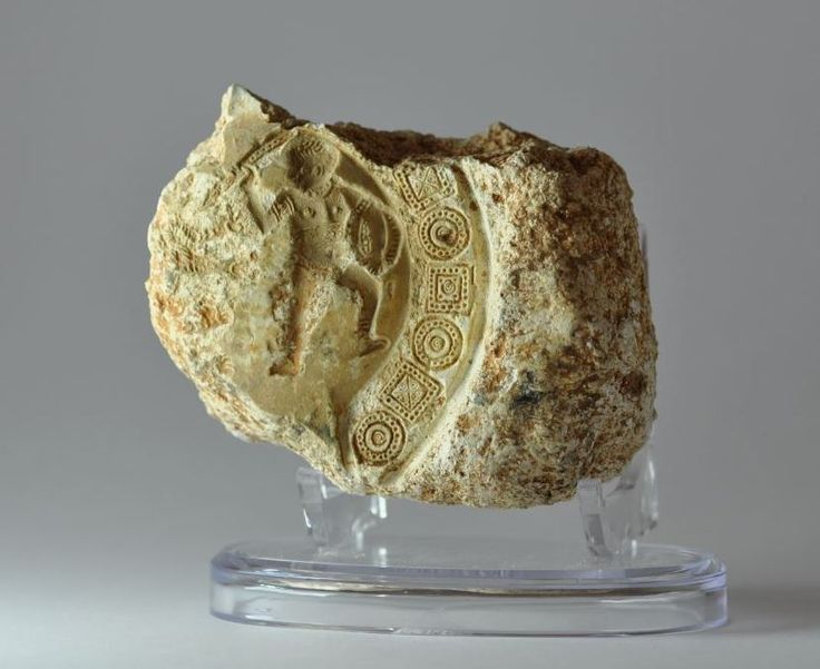 Roman oil lamp mould with gladiator and lion, 4th century A.D. African red slip ware lamp mould North Africa, gladiatior with sword and shield with lion, decorated around  with geometric motives, 10 cm x 7 cm x 4 cm. Private collection